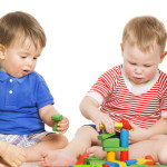 Children Group Playing Toy Blocks. Little Kids Early Development
